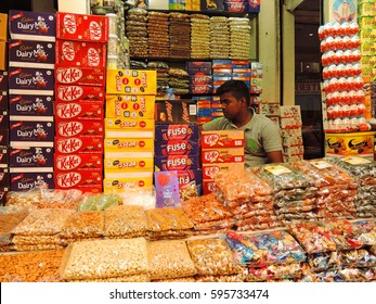 Kolkata, India - March 04, 2017: A man selling wide variety of food items in his grocery shop.