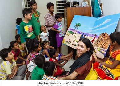Kolkata, India - March 11, 2015: Missionary girl teach poor rural indian children in the school