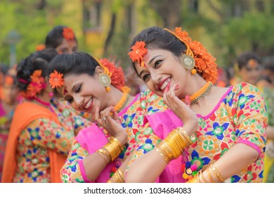 KOLKATA , INDIA - MARCH 12, 2017: Young girl dancers , dressed in yellow and red coloured sari (traditional Indian dress) dancing at Spring festival, ie, Dol (in Bengali) or Holi (in Hindi).