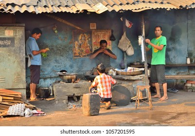 Kolkata, India - March 18, 2017: People sitting inside a small roadside eatery.