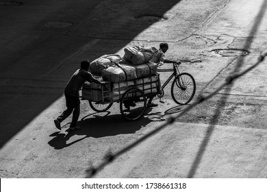 Kolkata, India - March 2020: Lockdown for COVID-19 - Men carrying essentials