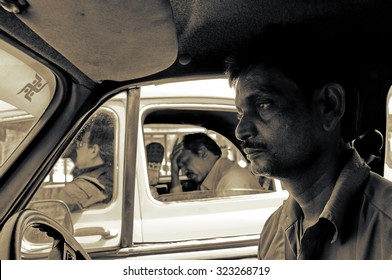 KOLKATA, INDIA : March 21, 2014 :  Indian driver looking bored and frustrated while stuck in a traffic jam in Kolkata