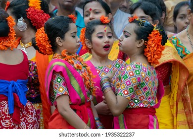 Kolkata, India - March 21st 2019 : Beautiful young girls in spring festive make up, in playful mood at Holi festival, known as Dol (in Bengali) or Holi (in Hindi) celebrating arrival of Spring.