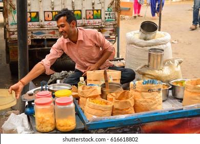 Kolkata, India - March 26, 2017: A street vendor selling variety of snacks.