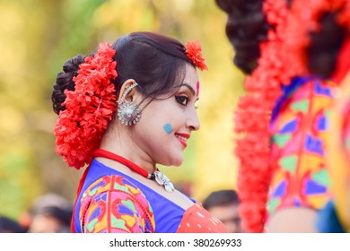KOLKATA , INDIA - MARCH 5, 2015 : Young girl dancer's joyful expression at Holi / Spring festival,known as Dol (in Bengali) or Holi (in Hindi) celebrating arrival of Spring in India. Popular festival.