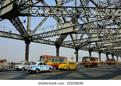 KOLKATA, INDIA. March21, 2014 : Indian bus on Howrah bridge where bear more than 100,000 vehicles and 150,000 pedestrians everyday. Howrah Bridge is  over the Hooghly River in West Bengal, India.