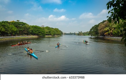 KOLKATA, INDIA, MAY 02, 2017: Scenic city landscape view of Rabindra Sarobar lake with people practicing for the regatta boating race held annually. An important city landmark for morning walkers.