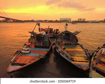Kolkata, India - May 06, 2017: People riding a boat across the river ganges during sunset.