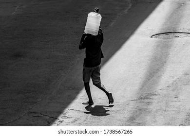 Kolkata, India - May 2020: Lockdown for COVID-19 - Man carrying water