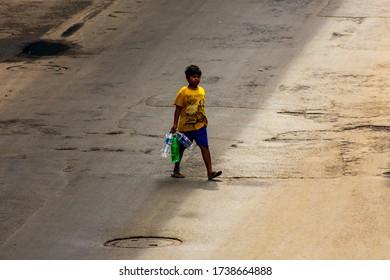 Kolkata, India - May 2020: Lockdown for COVID-19 - Kid going to get water