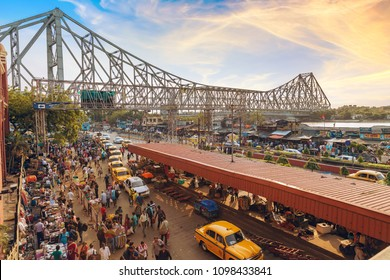 Kolkata, India, May 25,2018: Historic Howrah bridge with aerial view of city road with cabs in queue as seen from Howrah railway station Kolkata at sunrise.
