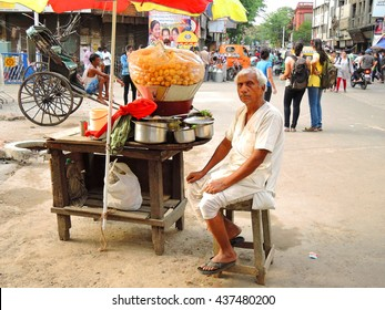 Kolkata, India - May 29, 2016: A street vendor selling panipuri, a common street snack in the road.