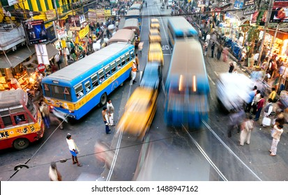 KOLKATA, INDIA: Motion blur from rushing buses and taxi cars, on crossroad of crowded city with local people on January 17, 2016. Kolkata has population near 5,000,000 people