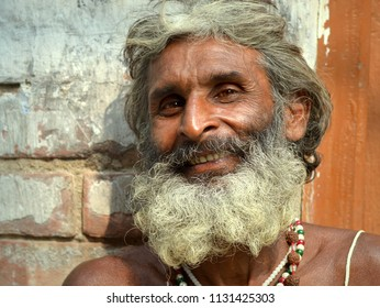 KOLKATA, INDIA - NOV 11, 2016: Smiling Indian Hindu devotee with thick beard poses for the camera, on Nov 11, 2016.