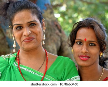 KOLKATA, INDIA - NOV 6, 2014: Dressed-up couple of East Indian gender queer street workers (Hijra people) poses for the camera, on Nov 6, 2014.