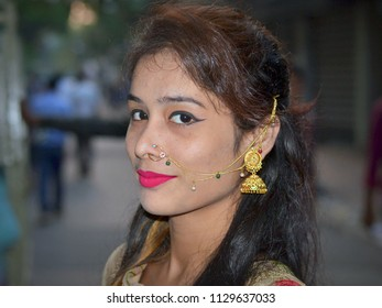 KOLKATA, INDIA - NOV 6, 2016: Attractive, young Bengali woman with makeup and expensive face jewelry poses for the camera, on Nov 6, 2016.