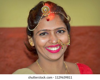 KOLKATA, INDIA - NOV 6, 2016: Attractive Indian Bengali bride with expensive wedding jewelry smiles for the camera, on Nov 6, 2016.
