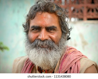 KOLKATA, INDIA - NOV 9, 2016: Indian Hindu devotee with smiling eyes poses for the camera, on Nov 9, 2016.