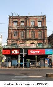 KOLKATA, INDIA - NOVEMBER 25: An aging, decaying, ex-colonial tenement block with shops in Kolkata, West Bengal, India on November 25, 2012.