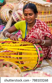 KOLKATA, INDIA - NOVEMBER 26: A craftswoman creates colorful cane baskets for sale during the annual State Handicrafts Expo 2016 on November 26, 2016 in Kolkata, West Bengal, India.