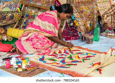 KOLKATA, INDIA - NOVEMBER 26: A handicraft artist paints on colorful handicraft items for sale during the annual State Handicrafts Expo 2016 on November 26, 2016 in Kolkata, West Bengal, India.
