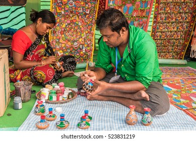KOLKATA, INDIA - NOVEMBER 26: An Indian artisan family creates colorful handicraft items for sale during the annual State Handicrafts Expo 2016 on November 26, 2016 in Kolkata, West Bengal, India.