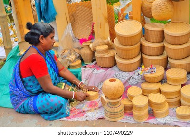 Kolkata, India - November 27, 2016: A woman selling bamboo and cane items in her stall.
