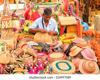 Kolkata, India - November 27, 2016: A street vendor making woolen bags by the roadside
