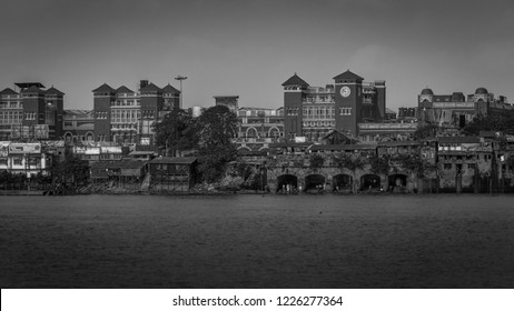 KOLKATA, INDIA - NOVEMBER 4, 2018: A black and White view of Howrah Station as viewed from Mallick Ghat. Howrah railway station is a historic colonial structure.