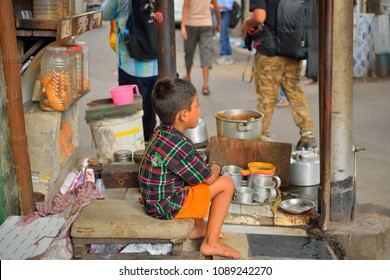 Kolkata, India - October 01, 2016: A child selling tea in a local roadside stall.