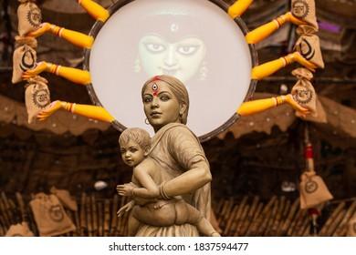 "Kolkata, India - October 2020: Maa Durga idol as migrant worker displayed for Durga Puja festival at ""Behala Barisha club"" in Kolkata, West Bengal."
