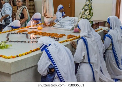 KOLKATA, INDIA - OCTOBER 30, 2016: Sisters of The Missionaries of Charity pray at Mother Teresa tomb in Mothers House in Kolkata, India.