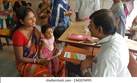 Kolkata, India - Sep 06,18: The mother of the under five child who is suffering looks happy after consulting the doctor.