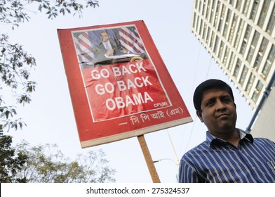 """KOLKATA - JANUARY 24:  A protester carrying """" Go Back Obama"""" sign to protest Obama's three day visit India to attend India's Republic Day parade on January 24, 2015 in Kolkata, India."""