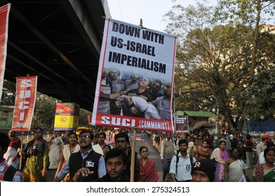KOLKATA - JANUARY 24: Protesters carrying signs denouncing  US-Israel imperialism  to protest Obama's three day visit India to attend India's Republic Day parade on January 24, 2015 in Kolkata, India.