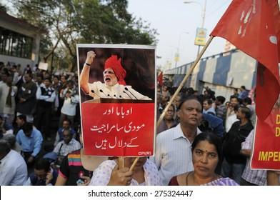 KOLKATA - JANUARY 24: Women holding anti-Modi signs to protest Obama's three day visit India to attend India's Republic Day parade on January 24, 2015 in Kolkata, India.