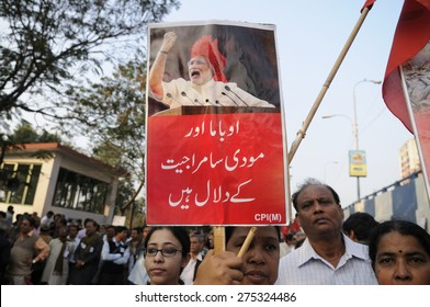 KOLKATA - JANUARY 24:Protestors with anti Modi signs written in Urdu during a rally to protest Obama's three day visit India to attend India's Republic Day parade on January 24, 2015 in Kolkata,India.