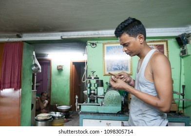 KOLKATA- JUNE 8: Ranjit- A worker inspecting the chains while manufacturing gold chains or necklaces in India-the largest consumer of gold on 8th June, 2015 in Kolkata, India.