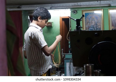 KOLKATA- JUNE 8: A worker inspecting gold chains while manufacturing gold chains or necklaces in India-the largest consumer of gold on 8th June, 2015 in Kolkata,India.