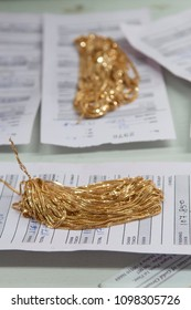 KOLKATA- JUNE 8:Chains being matched with invoices while manufacturing gold chains or necklaces in India-the largest consumer of gold on 8th June, 2015 in Kolkata,India.