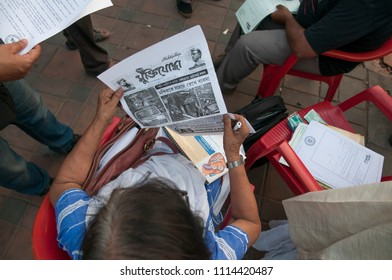 KOLKATA- MARCH  1: An old woman reading a newspaper during a rally to condemn the killing of  Bangladeshi blogger Avijit Roy by radical Islamist groups on 1st March in Kolkata, India.