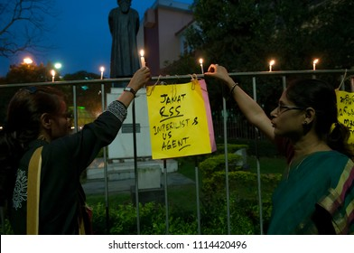 KOLKATA- MARCH  1: A woman sticking a banner to the fences during a rally to condemn the killing of  Bangladeshi blogger Avijit Roy by radical Islamist groups on 1st March in Kolkata, India.