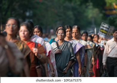 KOLKATA - MARCH 18: Women marching in a rally  to protest gang rape of a 70 year old nun in Kolkata, India on March 18, 2015