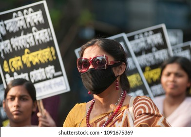 KOLKATA - MARCH 18: Women wearing black bands on their face while marching in a rally  to protest gang rape of a 70 year old nun in Kolkata, India on March 18, 2015