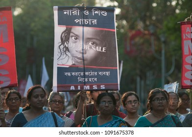 KOLKATA - MARCH 18:People carrying signs and banners to denounce a barbaric act during a rally to protest gang rape of a 70 year old nun in Kolkata, India on March 18, 2015