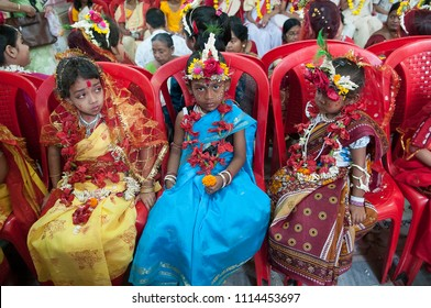 KOLKATA- MARCH  27: Girls sitting together waiting to be worshipped during Kumari (young unmarried Hindu girl) Puja festival in Adyapith near Kolkata on 27th March, 2015.