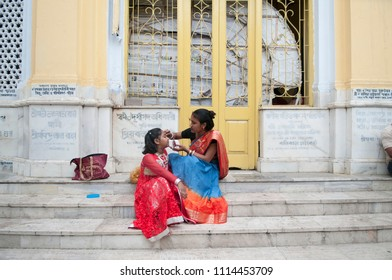 KOLKATA- MARCH  27: Parents fixing their childs hair and make up during Kumari (young unmarried Hindu girl) Puja festival in Adyapith near Kolkata on 27th March, 2015.
