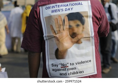 KOLKATA - NOVEMBER 15 :A man wearing a sticker denouncing violence against men and children during a rally to celebrate the International Men's Day on November 15, 2014 in Kolkata, India.
