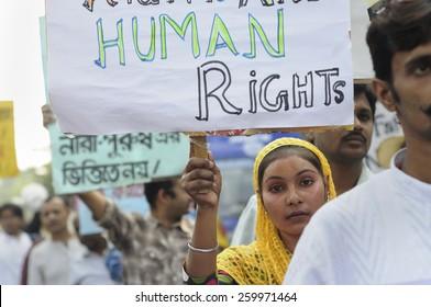 KOLKATA - NOVEMBER 15 :A Muslim girl holding pro men signs during a rally to celebrate the International Men's Day on November 15, 2014 in Kolkata, India.
