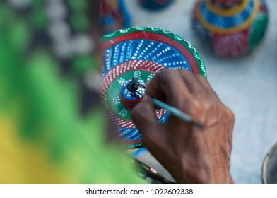 KOLKATA- NOVEMBER 26 :An Indian artisan painting on a flower pot  during the Handicraft Fair on 26th November, 2014 in Kolkata, India